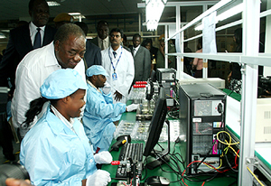 President Rupiah Banda talks to workers at the Mobile Telecommunications mobile telephone assembly plant in Lusaka