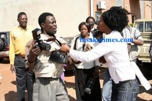 Henry Kapoko's sister Angela harrassing Zambia Daily mail photojournalist John Ngoma at the Lusaka magistrate court