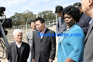 Ministry of Sport,Youth and Child development Permanent Secretary Susan Sikaneta (in blue) is surrounded by officials from CHinese An Hui construction firm who have been engaged to repair the Independence stadium.