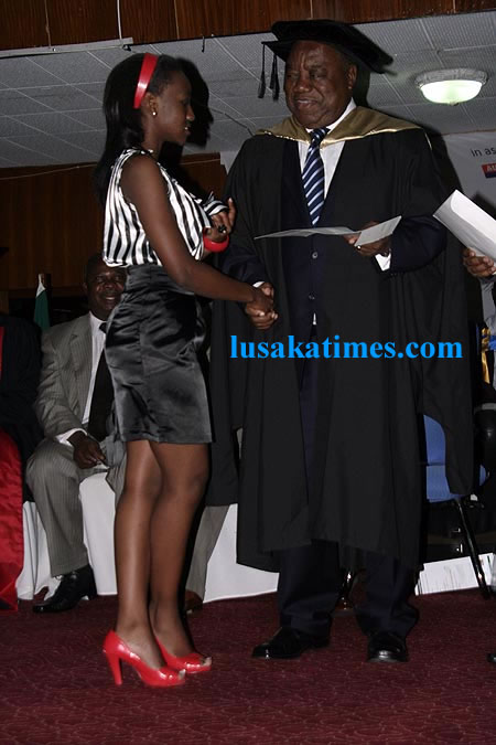 President Banda presents a diploma to one of the graduands at the Australian Institute of business and technology