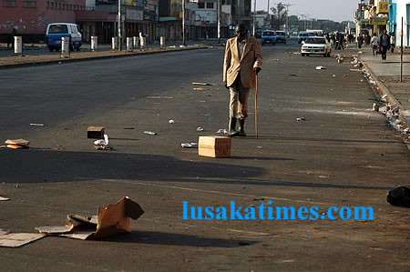 An old man walking along Freedom Way after vendors were removed from the street in Lusaka