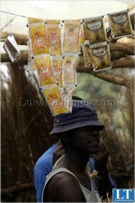 A youth in business cashing in on Tujilijili (brandy or gin packed in small sachets)
