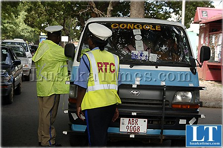 File picture:Give us a bribe...Traffic police officers confront a public service bus driver at Longacres in Lusaka