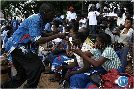 An unidentified women jostles for free condoms