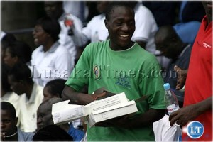 Free condoms..save your life...an unidentified man distributes condoms during the World AIDS day celebration in Lusaka