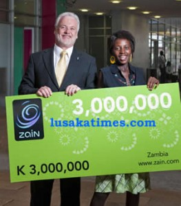 Zain Zambia Managing David Holliday hands over the K3 million scratch card to the winner 18year old Edna Mwamba