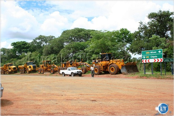Sable Construction Company earth moving machines lined up before President Rupiah Banda officially flagged off the works of the tarring of the Chipata/Mfuwe road in Chipata