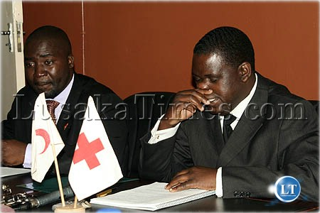 Zambia Red Cross Society General Secretary Charles Mushitu (r) and public relations manager James Zulu (l) talk to journalists on the Haiti earthquake aid appeal in Lusaka
