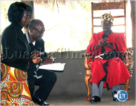 Copperbelt Permanent Secretary Vlllie Lombanya and Mpongwe District Commissioner Mineva Mtesa pay homage to Chief Machiya of the Lamba people during tour of Mpongwe district to visit Lamba chiefs
