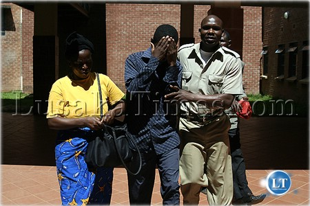 Now you see me...A prophet who was jailed for having sex with a minor tries to shy away from the camera at the Lusaka Magistrate