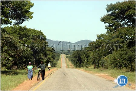 Villagers walking along the great east road to access services such as health and markets in eastern province