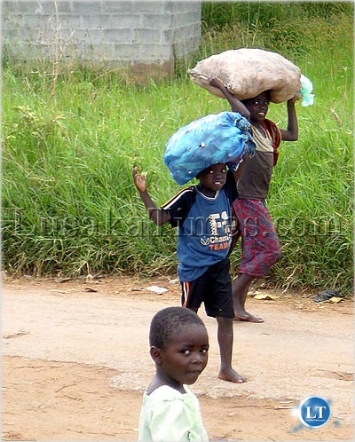 Child labour is rife on the Copperbelt. Here, some children ferrying heavy loads in Ndola