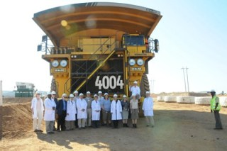 Members of the Foreign Affairs Committee of the Danish Parliament and officials from their Zambian embassy are dwarfed by giant 300-tonne Komatsu dump truck on their recent visit to the Chingola Open Pits operations of Konkola Copper Mines.
