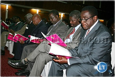 Some Permanent Secretaries study the revised government instructions book in Lusaka