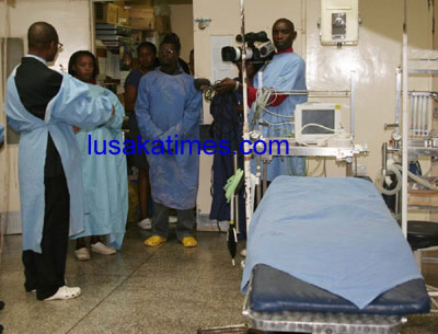Health Minister Kapembwa Simbao (l) talks to journalists during the tour of University Teaching Hospital theatres
