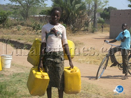 A  girl going to fetch  water