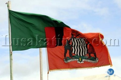 The Zambian flag flies along the Presidential flag characterised by the Coat Arms