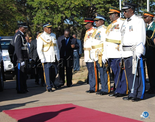 COMMANDER-in-Chief of the Armed Forces, President Banda meets Service Chiefs as he arrives at ZAFLivingstone Air Base for the Commissioning Parade