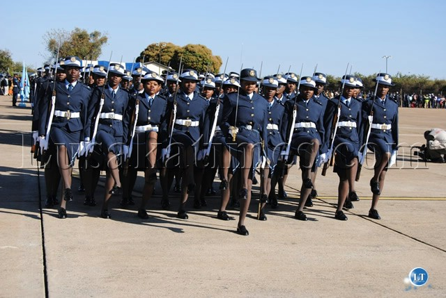 GRADUATING female Officer Cadets take salute before the Commander-in-Chief of the Armed Forces President Banda at the ZAF Livingstone Air Base