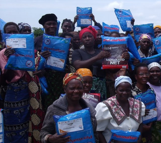 Women posing with their newly donated Mosquito nets