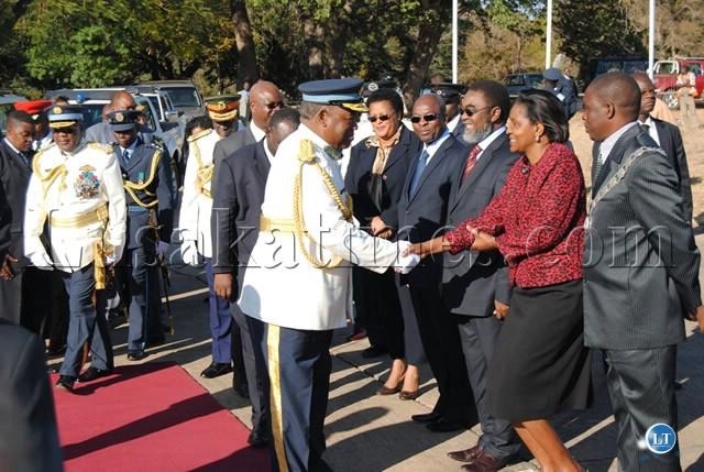 PRESIDENT Banda greets Home Affairs Permanent Secretary Ndioyi Mutiti as he arrives for the ZAF Commissioning Parade at ZAF Livingstone Air Base