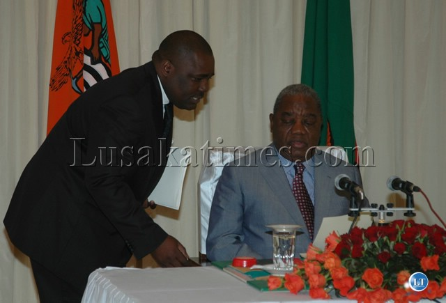 PRESIDENT Rupiah Banda with Special Assistant for Press and Public Relations Mr.Dickson Jere during the occasion of the dissolution of the National Assembly at State House