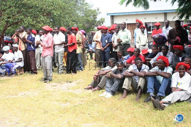 File:Mongu residents  listening  to the proceeding to the Barotse National Council in Limulunga Royal Village