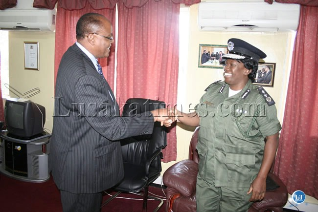 Western Province Permanent Secretary Augustine Seyuba greets Inspector General of Police Stella Libongani