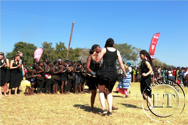 Americans student from Seattle University participates in dances at the Lwiindi traditional ceremony in Monze at the weekend. They are on attached the Mukanzubo cultural centre