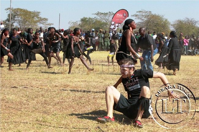 An American student from Seattle University participates in dances at the Lwiindi traditional ceremony in Monze at the weekend. He is on attached the Mukanzubo cultural centre