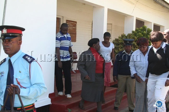 Central province Permanent Secretary Inutu Suba iswhisked away by police officers after civil servants threatened to grag her out of her office in Kabwe