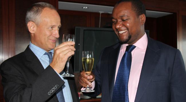 Deutsche Bank head of bond syndicate Nigel Cree (left) and Zambia?s Finance Deputy Minister Miles Sampa in New York on 13 September, 2012. PHOTO | CHIBAULA D. SILWAMBA | GRZ