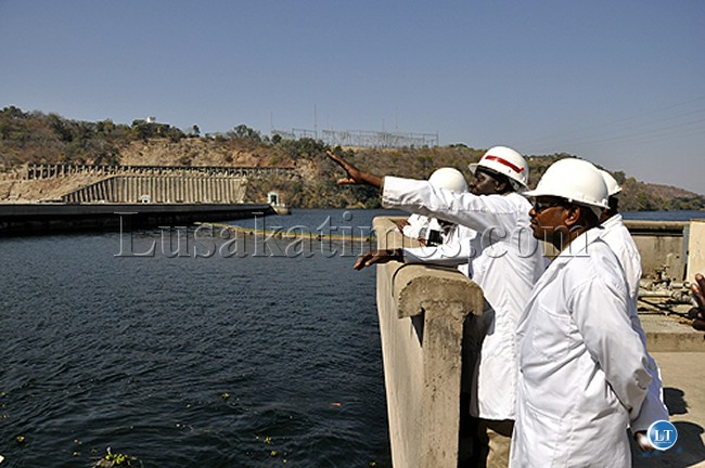 ZESCO Limited officials inspect the waters at Lake Kariba where the utility firm generates power