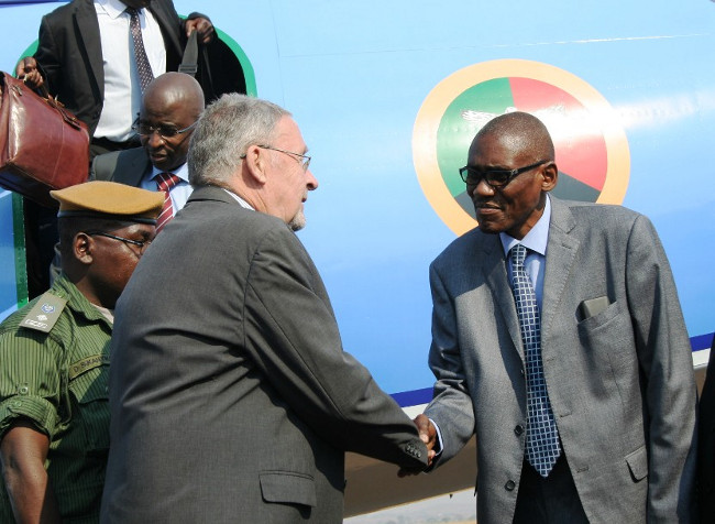 Eastern Province Minister, Charles Banda, welcomes Republican Vice President, Dr. Guy Scott, at Chipata airport. Dr. Scott is in Chipata to officially open the SOS Children's village.