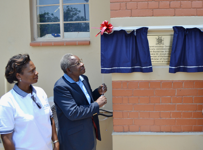 Health Minister Dr Joseph Kasonde unveils the plague to mark the official opening of the refurbished University Teaching Hospital Eye Centre of Excellence in Lusaka, Looking on is the head of eye clinic at UTH, Grace Mutati