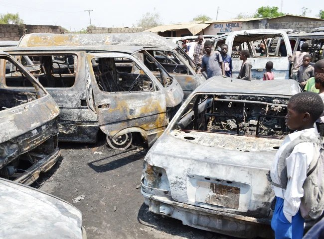 OVER 30 public service minibuses and other vehicles were yesterday destroyed in an inferno in a car park in Lusaka's Kanyama Township. Here, residents salvaging spare parts from the remains