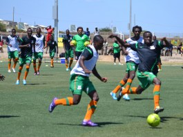 Zambia national team players go through a training session under theguidance of Head Coach Herve Renard (right) and Physical Trainer Patrice Beaumelle at the Olympic Youth Development Center in Lusaka