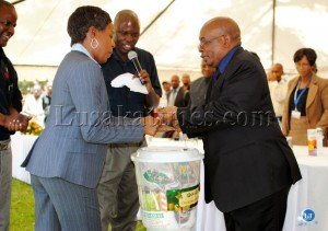EDUCATION Minister John Phiri presents a hamper to Lusaka Girls Basic School teacher Monica Mukwanga who is living with HIV/AIDS at the Ministry's Health Day commemoration in Lusaka