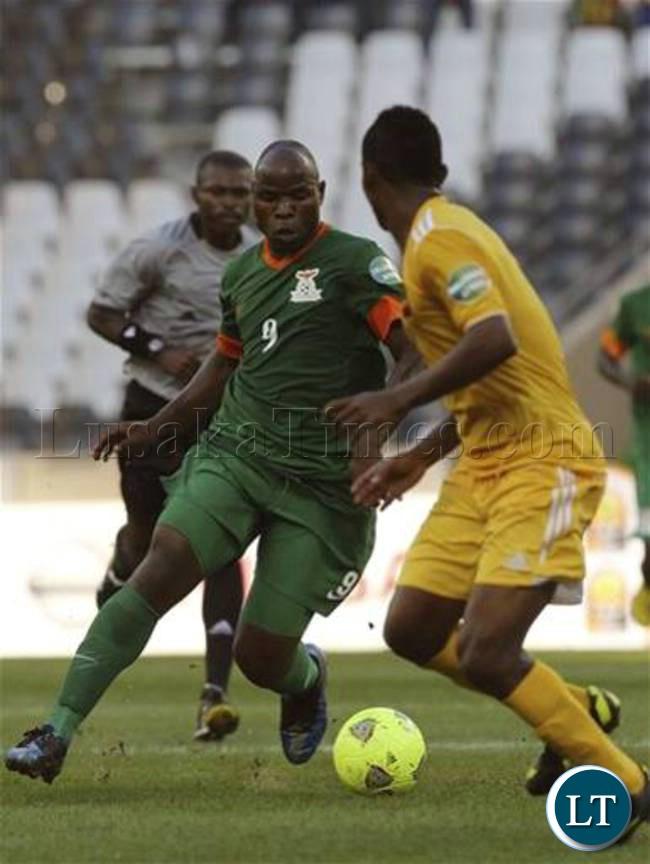 FILE: Collins Mbesuma dribbles way past Ethiopian Defenders