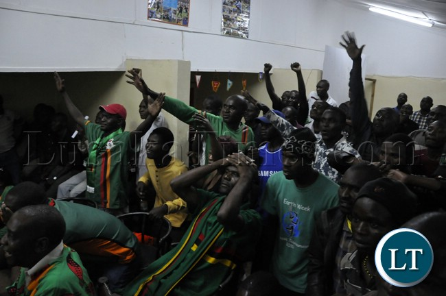 Soccer fans cheering the Chipolopolo team during the live broadcast of the match against Bukina Faso