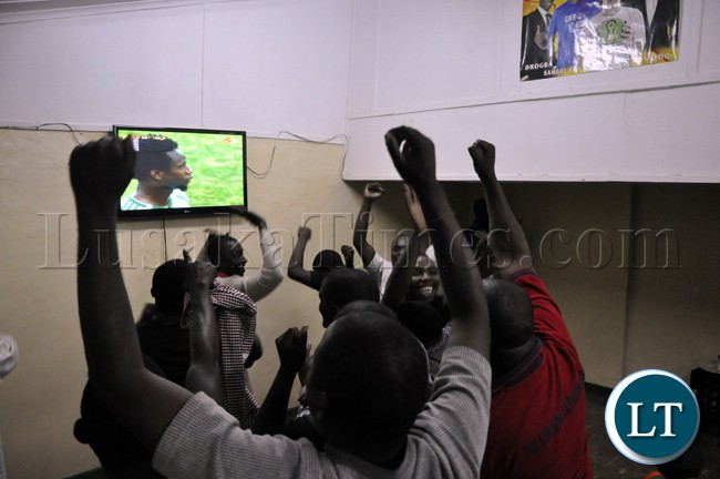 Soccer fans cheering the Chipolopolo team during the match against Bukina Faso which saw Zambia exit the AFCON 2013 event