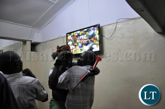 Some Lusaka based soccer fans celebrating Zambia's performance during the Zambia Bukina Faso game