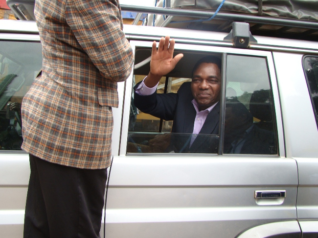 UNITED Party for National  Development  (UPND) leader Hakainde Hichilema waves at by standers (not in picture) after Mazabuka Central Member of Parliament Garry Nkombo and seven others were set free by the magistrate court in Livingstone