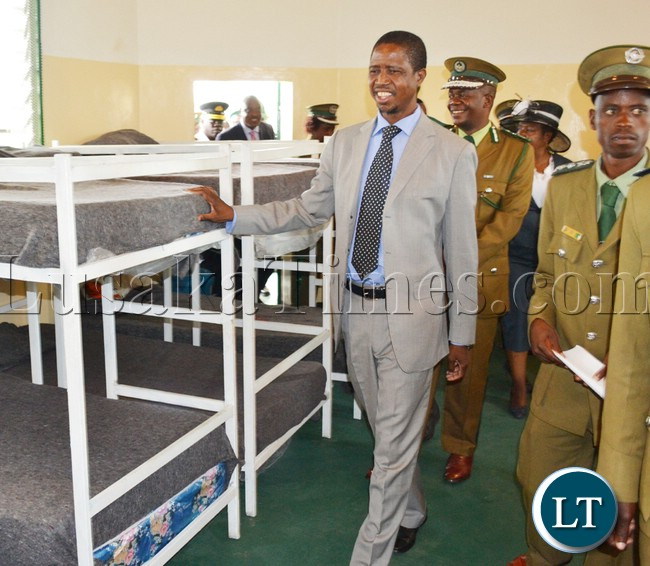 NICE beds…Home Affairs Minister Edgar Lungu flanked by Prison Service Commissioner Percy Chato (behind) inspect one of the dormitories for inmates at the newly commissioned Mwembeshi Maximum security prison in Mumbwa district