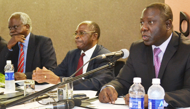 FORMER Zambia Railways Limited board vice chairperson Professor Oliver Saasa (right) flanked by Chairperson Mark Chona (middle) and board member Geoffrey Mulenga addresses journalists
