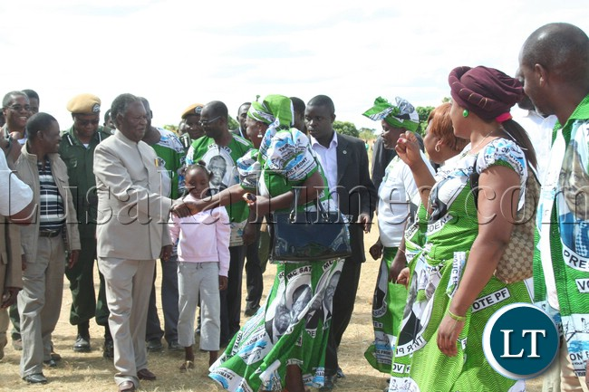 President Michael Sata greeting the patriotic front members upon arrival at meembe basic school grounds ,where he held a rally in support of the kapiri mposhi  bye election (PF) candidate Eddie Musonda