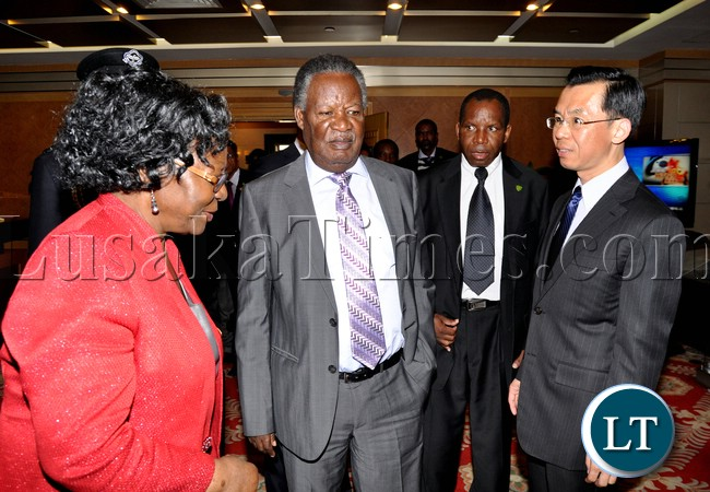 President Michael Sata with Ministry of Foreign Affairs-African department Director General Lu Shaye (c) nd Zambia's Ambassador to China Eva Fundafunda (l) at Beijing International Airport shortly before departure for Sanya in China on April 5,2013-Picture by THOMAS NSAMA