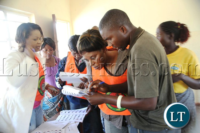 Elections officials verifying details of a voter during elections at matilyo polling station in Kapiri Mposhi
