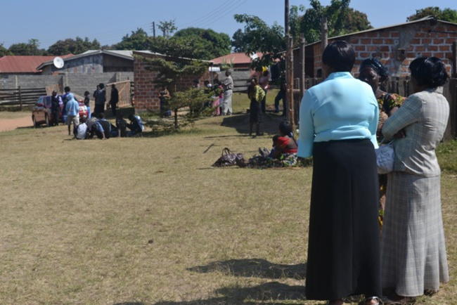 SOME of the Saint Peters' Anglican Church members stranded outside the locked church building