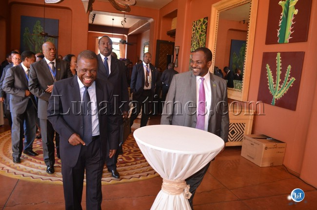 FILE: Then Justice Minister Wynter Kabimba (left) and Director of Public Prosecutions Mutembo Nchito (right) sharing light moments at the just ended 2013 Southern African Chief Justices Forum and Conference and Annual General Conference at Zambezi Sun Hotel in Livingstone